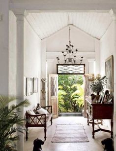 The Guest House at Hibiscus Hill   Design by India Hicks. Stunning dining room designed by Alanna Smit Designs and photographed by Simon Whitbread. The beautiful vintage window frame turned mirror is from Manyara Home, topped off with white, rattan, palm leaves and a giant clamshell – just beautiful! Tropical bathroom via Fanimation. The rattan fan …