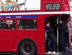 red double-decker bus // tend to see them in the big cities. // Can you pick out anyone on //