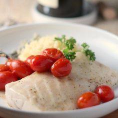 Paiche, a firm, white fish similar in taste to halibut, is easy to prepare roasted with tomatoes for a healthy meal.