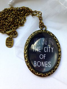 "The Mortal Instruments City Of Bones Inspired Necklace - With Quote ""Welcome To… Jace Lightwood, Mortal Instruments Books, City Of Glass, City Of Ashes, Cassie Clare, Nerd, Cassandra Clare Books, Jamie Campbell Bower, Book Jewelry"