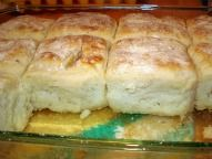 2 cups Bisquick  ½ cup sour cream  ½ cup 7-up  ¼ cup melted butter  Cut sour cream into biscuit mix, add 7-Up. Makes a very soft dough.    Sprinkle additional biscuit mix on board or table and pat dough out. Melt ¼ cup butter in a 9 inch square pan. Place cut biscuits in pan and bake at 450 degrees until golden brown.
