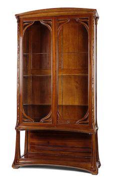 An Art Nouveau Ecole de Nancy carved mahogany cabinet circa 1900