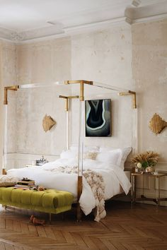 Oscarine Lucite Four-Poster Bed.  The refractive Lucite frame and gleaming cast brass accents of this bed are meant to catch the light, drawing all eyes to its Deco-inspired lines.