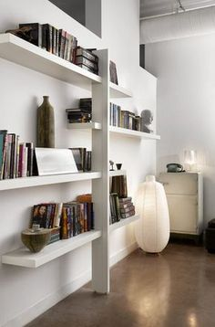 Ikea hack shelving unit - using staggered Lack shelves on a vertical support for strength  ~ Stephane Chamard