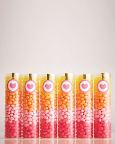 Tubes of Jelly Belly jelly beans in gradient colors ready for guests to tote home