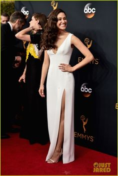 Emmy Rossum is wearing a Wes Gordon dress, Brian Atwood shoes, Fred Leighton jewels, and a Judith Leiber clutch