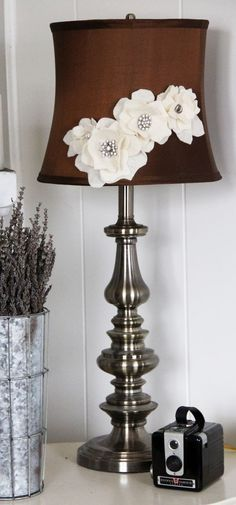 Hot-glue fake flowers to your lampshades.  Such a simple sweet touch, why didn't I ever think of this??