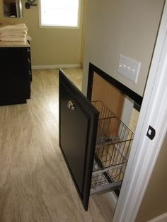 drawer that opens to closet but closets into the the laundry room. Use trash can  drawer slides and cabinet facing with baskets instead of plastic bins.