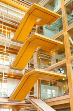 These mid-rise buildings all feature wood in innovative ways for building and design. View these commercial and residential projects with Think Wood. Amazing Architecture, Architecture Design, Ramp Stairs, Innovation Centre, Study Photos, Wood Laminate, Sustainable Design, Stairways, British Columbia