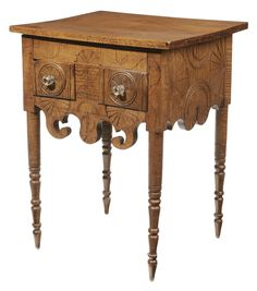 American Federal Folk Art Carved  Tiger Maple Two-Drawer Table Kentucky/Ohio area, 19th century, front and sides with elaborate fan and turned decoration, deeply scrolled skirt and turned legs, incised leaf and vine decoration, dovetailed drawers with poplar secondary, meticulously pinned construction throughout, 29 x 22-1/2 x 20 in.