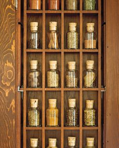 Small vials of spices- I made my own kitchen art piece like this & am making another one for my @Shea. :)