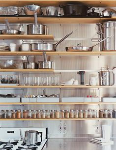 Kitchen.  Instead of being out in the open, how cool would it be to have one complete wall with open shelves like this, to see everything you need, and then pull down a roller door, or slide back a cupboard to close it off and keep it clean when not using... Ideas