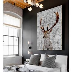 A stunning piece of artwork capturing the beauty of a Deer. There's something so very magical about the look of a Deer and the artist has captured its beauty to stunning results in this piece. The background features a subtle grey watermark design making it an easy piece to work into various interior styles. The piece is perfect for adding a striking focal point to a room.  The original artwork is professionally printed on 100% cotton canvas, then stretched by hand and gallery wrapped…
