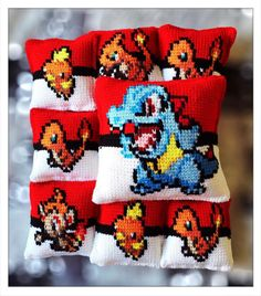 All available on the #cannon_ink etsy shop.  https://www.etsy.com/shop/CannonInk?ref=hdr_shop_menu #Totodile #Charmander #Charmeleon #Torchic #Chimchar #Pokeball #crochet #pillow #pixel #pixelart #knitpillow #anime