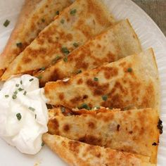 Buffalo Chicken Quesadillas.  Sooo good, I did not use butter and baked them instead and broiled them at the end to get crispy~KP