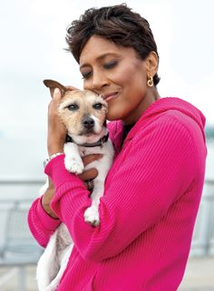 Robin Roberts stops to cuddle with her Jack Russell terrier, K.J. (for Killer Jack), during one of their frequent strolls along the Hudson River. http://www.guideposts.org/inspirational-stories/my-mother-my-inspiration?utm_source=Pinterest_medium=GP_campaign=KillerJack2_7.19.12