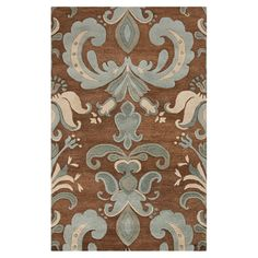 ROWLAND RUG in a lovely damask motif in sepia hues.