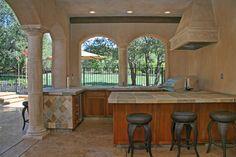 Beautiful outdoor kitchen with quartzite tile enjoy!  http://jimchandlerpools.com/