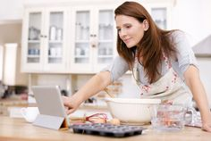 Woman baking and using iPad