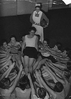 Women in the Third Reicht - Members of the Nazi girls' organization, the League of German Girls (BDM), do a group exercise. Dresden, Germany, December 1936.  — US Holocaust Memorial Museum