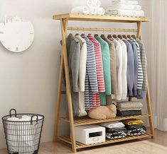 14 clothes racks that store your garments in style - Bamboo clothing rack Clothes racks are excellent storage solutions for bedrooms, entryways, laundry rooms and guestrooms. They give you easy access to all your garments, and they ar Oak Clothing, Wood Clothing Rack, Diy Clothes Rack, Clothes Stand, Wooden Clothes Rack, Clothes Rack Bedroom, Wardrobe Clothing, Wooden Rack, Clothes Storage
