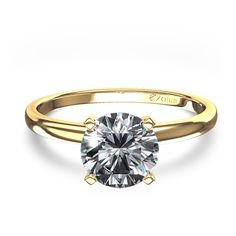 Round. Solitare. Yellow Gold. 4 prong. 1  (+) carat. Thin Band.     This is what I want <3