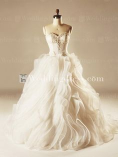Strapless ball gown wedding dress is so luxurious that will captivate your guests on your special day! Feminine sweetheart Lace bodice is adorned with sparkle beadings. Stumbled Tulle ball gown skirt adds movement and drama. Back is corset closure and chapel length train.
