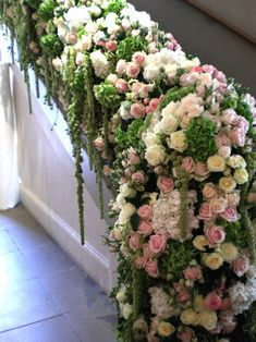 Elegant staircase for a bride to walk down. Decorated with tons of roses!