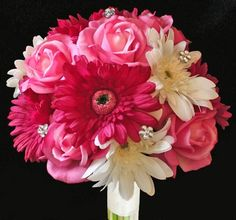 Bride's maids bouquets- light pink gerbers with dark pink roses and touches of purple.