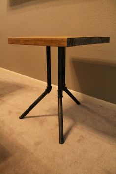 Black Industrial Pipe Legs with Wood Top Side by S2DesignStudio; don't see any reason the mr and i can't figure out how to do something like this…needing some tables for lamp-light!