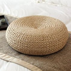 Natural cattail pouf with a steel construction inside.
