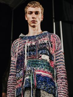 Unravelling knitwear at James Long SS16 LCM. Photography by Chloe Le Drezen