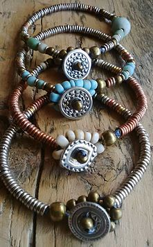 smelt-jewelry   BRACELETS  made from Kenyan Giriama beads, glass and brass and finished with a handcrafted pewter button