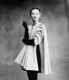 """#IrvingPenn shot his first couture portfolio for Vogue in 1950 in a studio located on the day-lit top floor of an old photography school on the rue de Vaugirard in Paris. The images he shot there, and which appeared in the September 1, 1950 issue, have become iconic. In this one, Lisa Fonssagrives, the future Mrs. Penn, wears Cristóbal Balenciaga's mantle coat, described by Vogue as having """"the sculptural, direct beauty of a Roman toga,"""" with the elegant, arched-brow hauteur that came to…"""