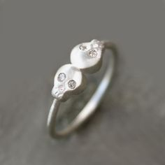 Double Baby Skull Ring in Sterling Silver with Diamonds