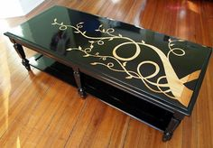 Reverse stencil, lacquered coffee table with wood grain...  Tutorial