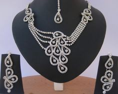 Costume Fashion Indian jewelry Silver plated Necklace set with Clear CZ stones studded-CZ12 http://www.craftandjewel.com/servlet/the-871/Custom-fashion-Indian-jewelry/Detail