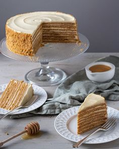 Medovik is the best cake you will ever make. Soft honey layers baked to golden perfection with a slightly tangy sour cream frosting. This cake is sheer heaven in every bite.  #medovik #medovikcake #honeycake #fallbaking #russiandesserts #russiancuisine #e