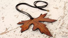 Realistic, bohemian chic, leaf necklace. Very detailed, textured, leaf imprint in rust brown. Pendant is made of polymer clay, with black