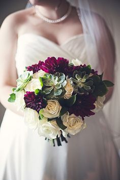 winter wedding bouquet of burgundy dahlias, ivory roses, and succulents www.redpoppyfloral.com