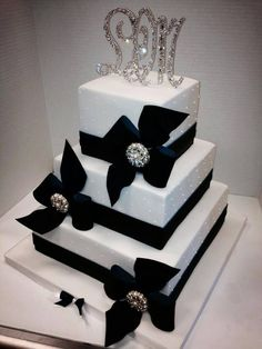"""For a """"black tie"""" wedding - a cake with black bows and bling"""