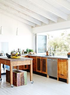 Kitchen, with views across the garden to the beach.  Kitchen cabinets made locally, butchers block sourced at vintage industrial auction.  T...