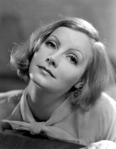 Actress Greta Garbo has thin, plucked eyebrows in this 1932 image. Thin eyebrows were a popular look in the 1930s thanks to stars like Garbo.