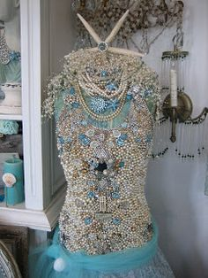 Bejeweled mannequin.