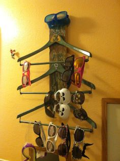 Glasses rack made from 3 Wishbone hangers and a fence board I found at my parents.