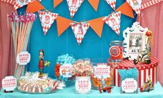 Carnival birthday with classic details and graphic design. LOVE the clown cake pops!