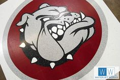 Bush Middle School Bulldog Mascot waterjet cut by Waterjet Works from Armstrong VCT