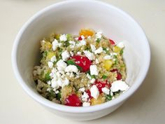 This SUPER-healthy AND DELICIOUS quinoa salad is packed with kiwi, mango, mandarin oranges, bell pepper, cherry tomatoes and cilantro, then dressed with an amazing lime-ginger vinaigrette!