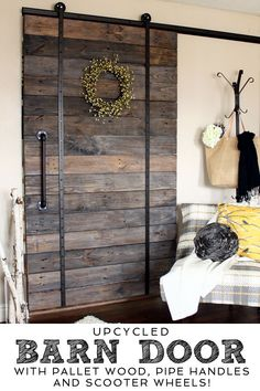 Upcycled Barn Door made with pallet wood, pipe handles and scooter wheels