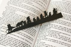 Hand-cut Silhouette Bookmark - The Fellowship of the Ring. $8,00, via Etsy.